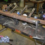 The front end tilt pivots on the push bar light bracket before being welded into place. 11-14-2012